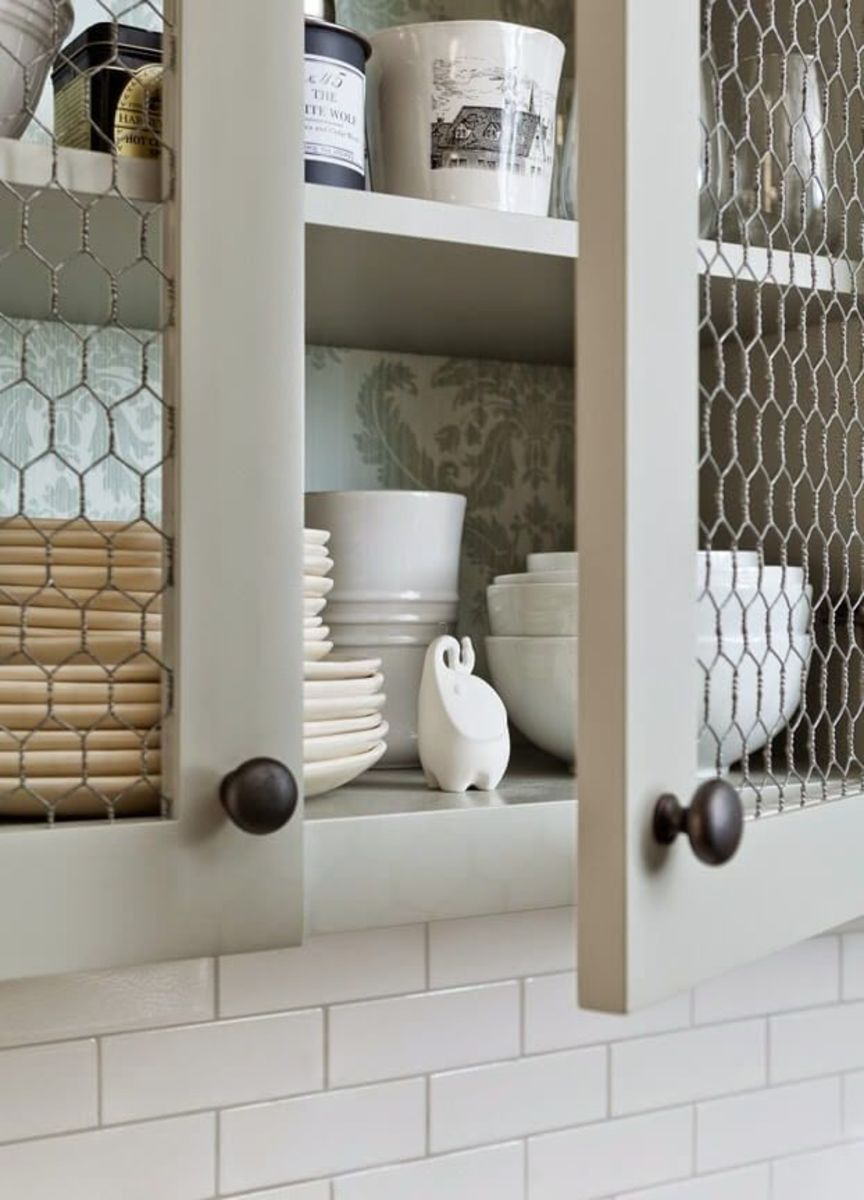 How to put chicken wire in a cabinet door. Chicken wire fronts on kitchen cabinets. Use the claw to remove the  panel of the cabinet door from the frame.