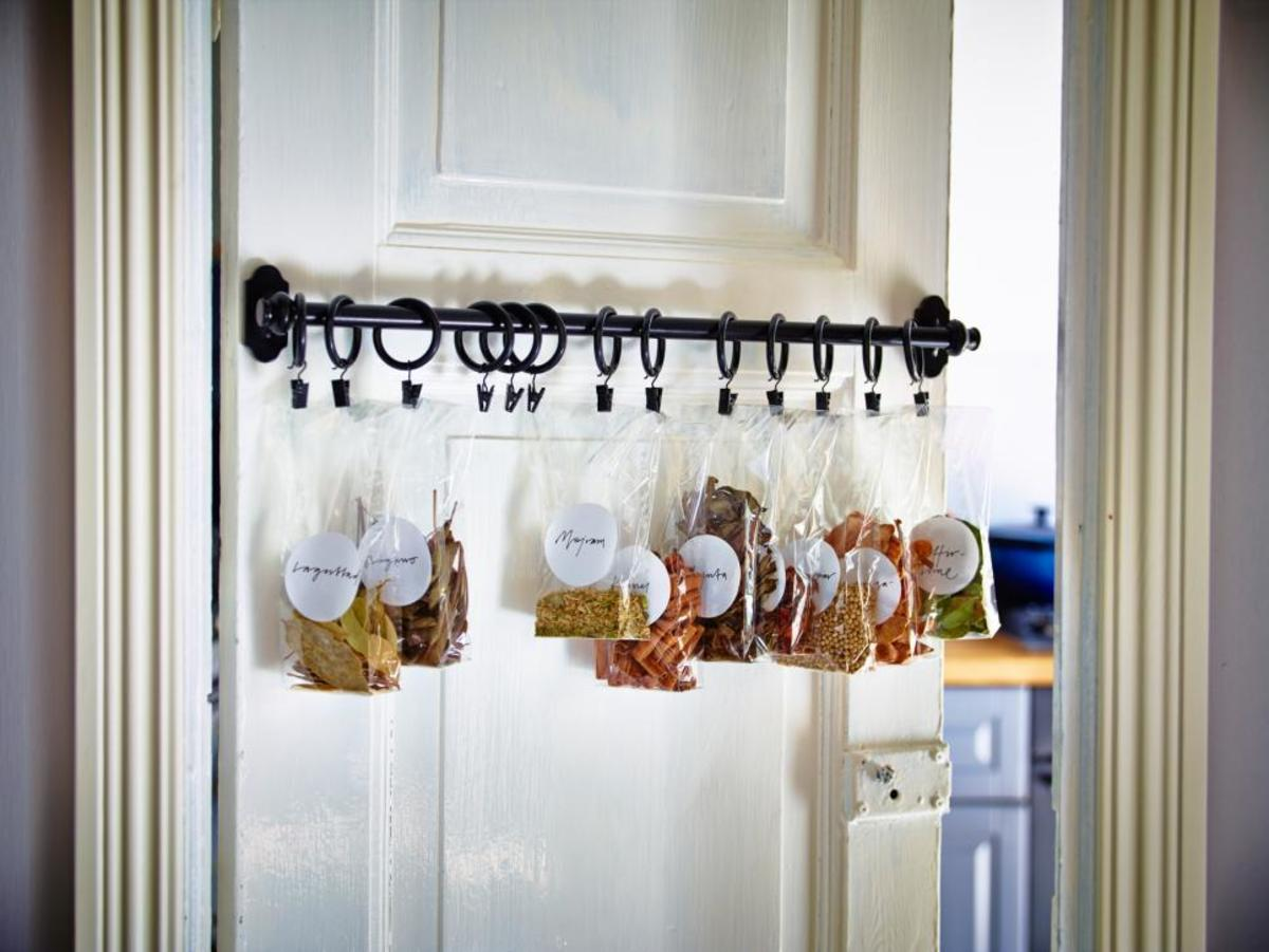Install a rod on the kitchen door  the curtain clips are on the tabs in the spices and herbs small plastic bags .