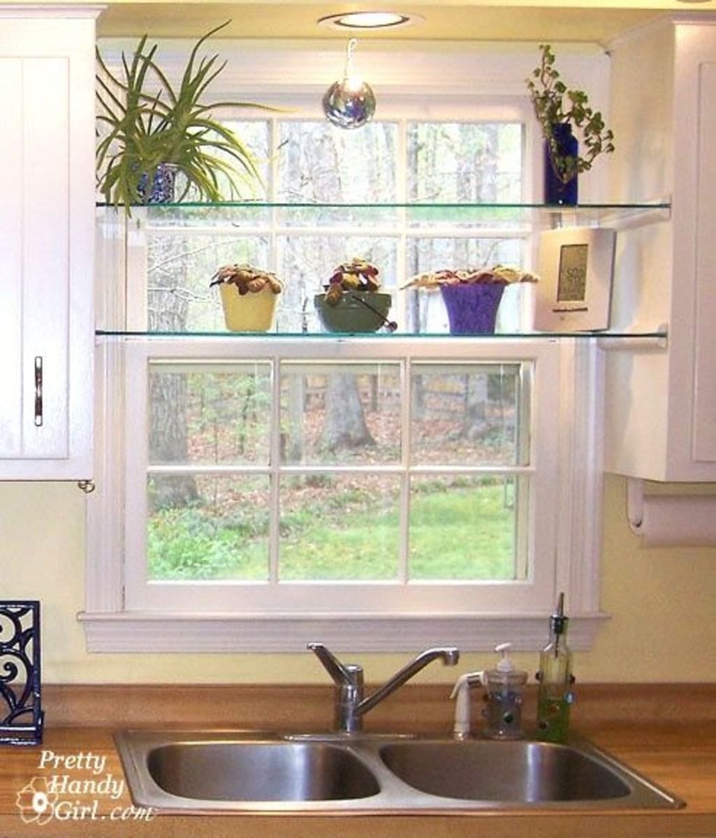 Installs your own glass shelves between two kitchen cabinets. Several are some of the plants. The glasses are shelves between the cabinets and over the window and above the sink.