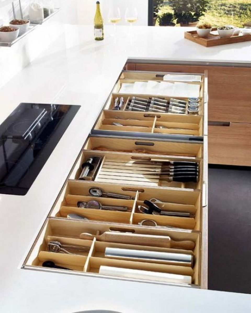 Neat organized kitchen drawers for knives, spoons and other similar utensils. The drawer organizers are definitely with that.