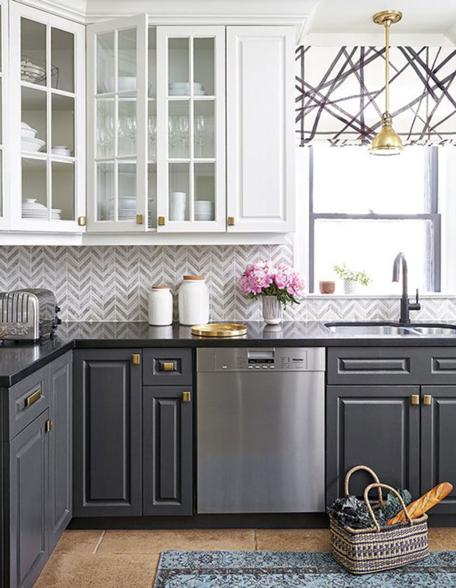 The kitchen cabinet white uppers and dark gray lowers look the two kind of colors.