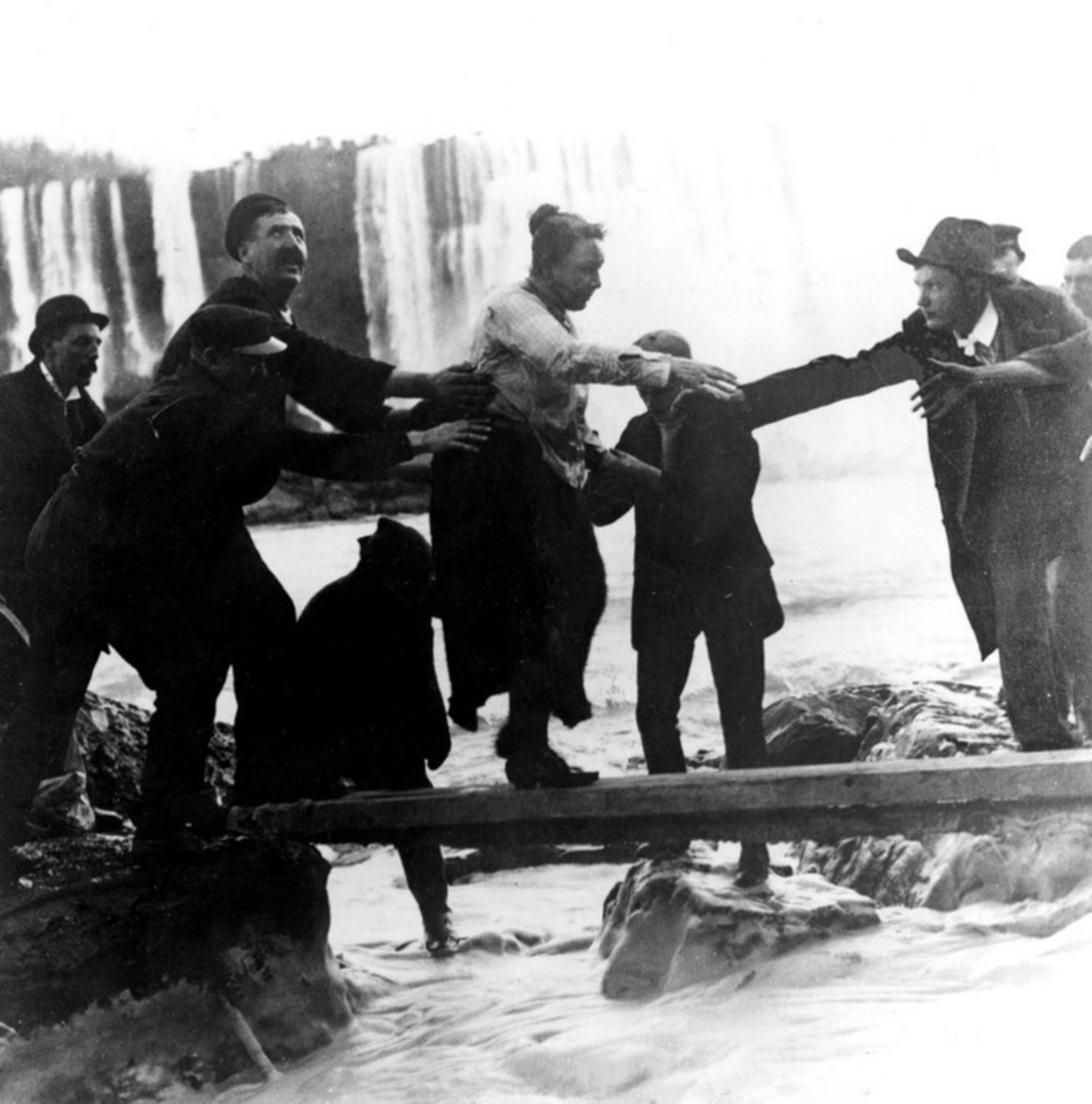 Annie Taylor being helped to shore after surviving stunt
