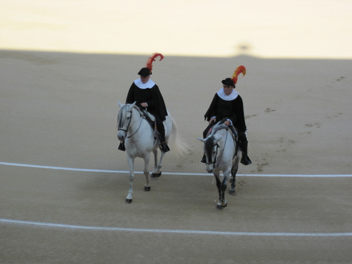 Two ceremonial assistants on horseback, before the fight begins