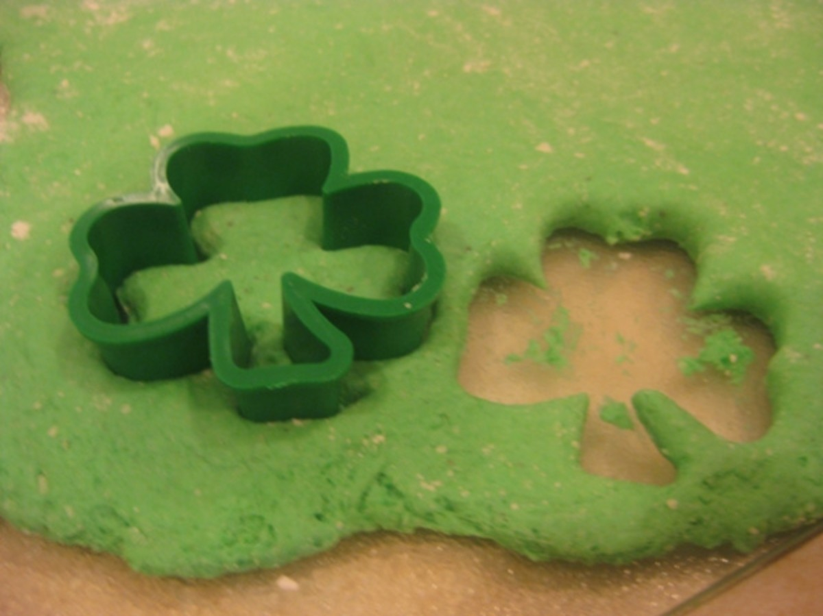 Cutting out the shamrocks.