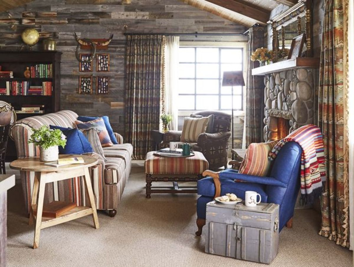 The Ox living room would look nice with stone elements and touches of blue. Leather looks great in an Ox home.
