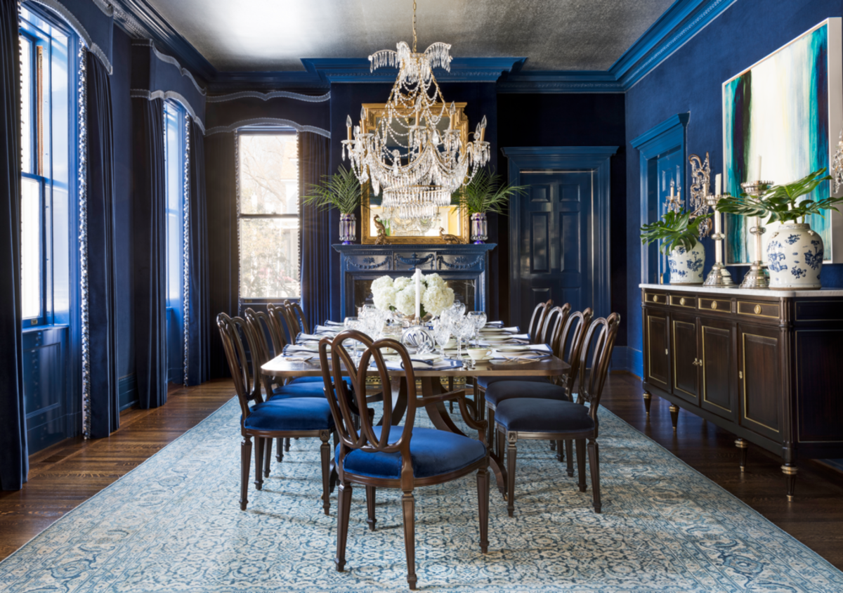 The Ox dining room has shades of blue, a long table for many guests, and a rug to bring everything together. The Ox prefers a practical dining area with conservative tastes.