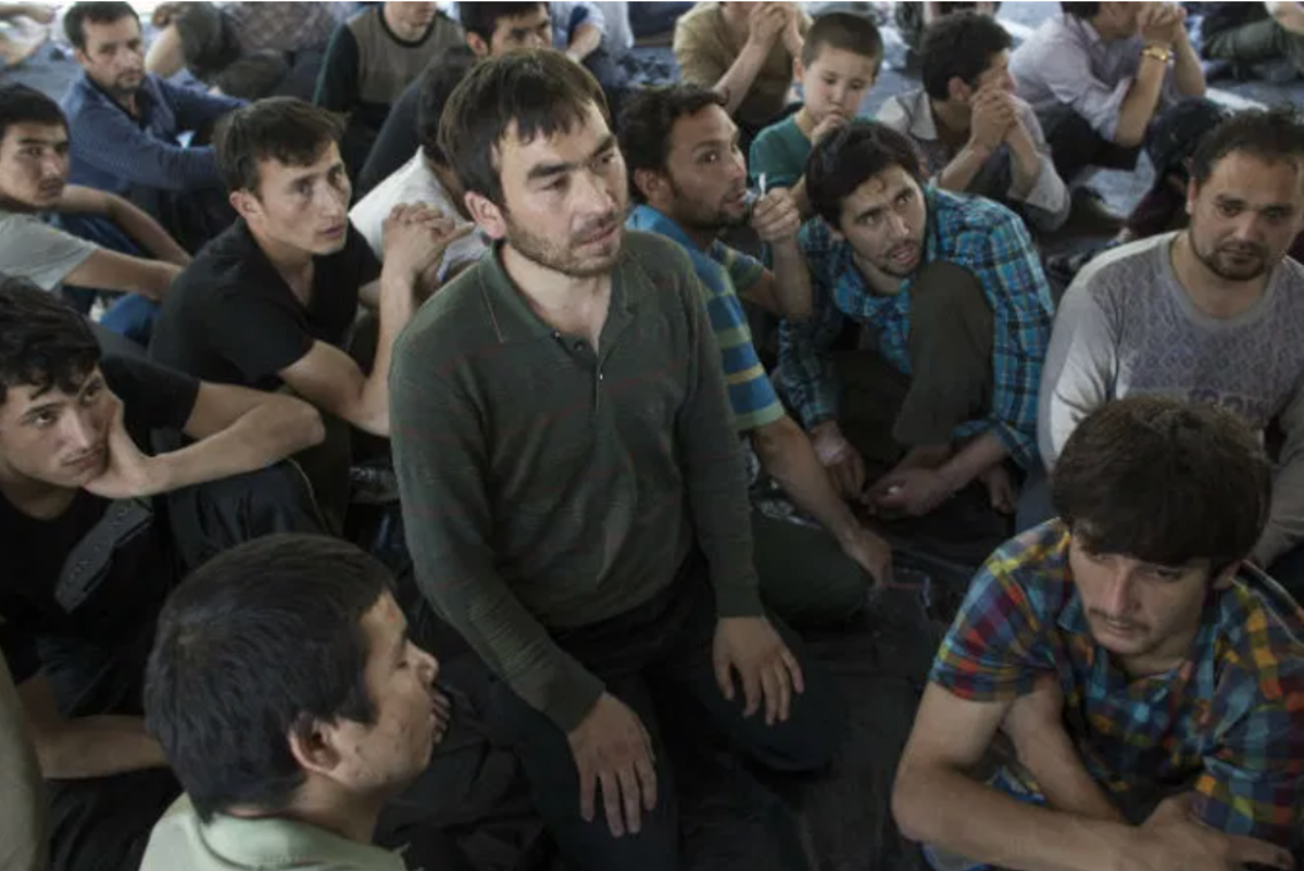 From Athit Perawongmetha/Reuters.  Uighur Muslims in interment camps in China