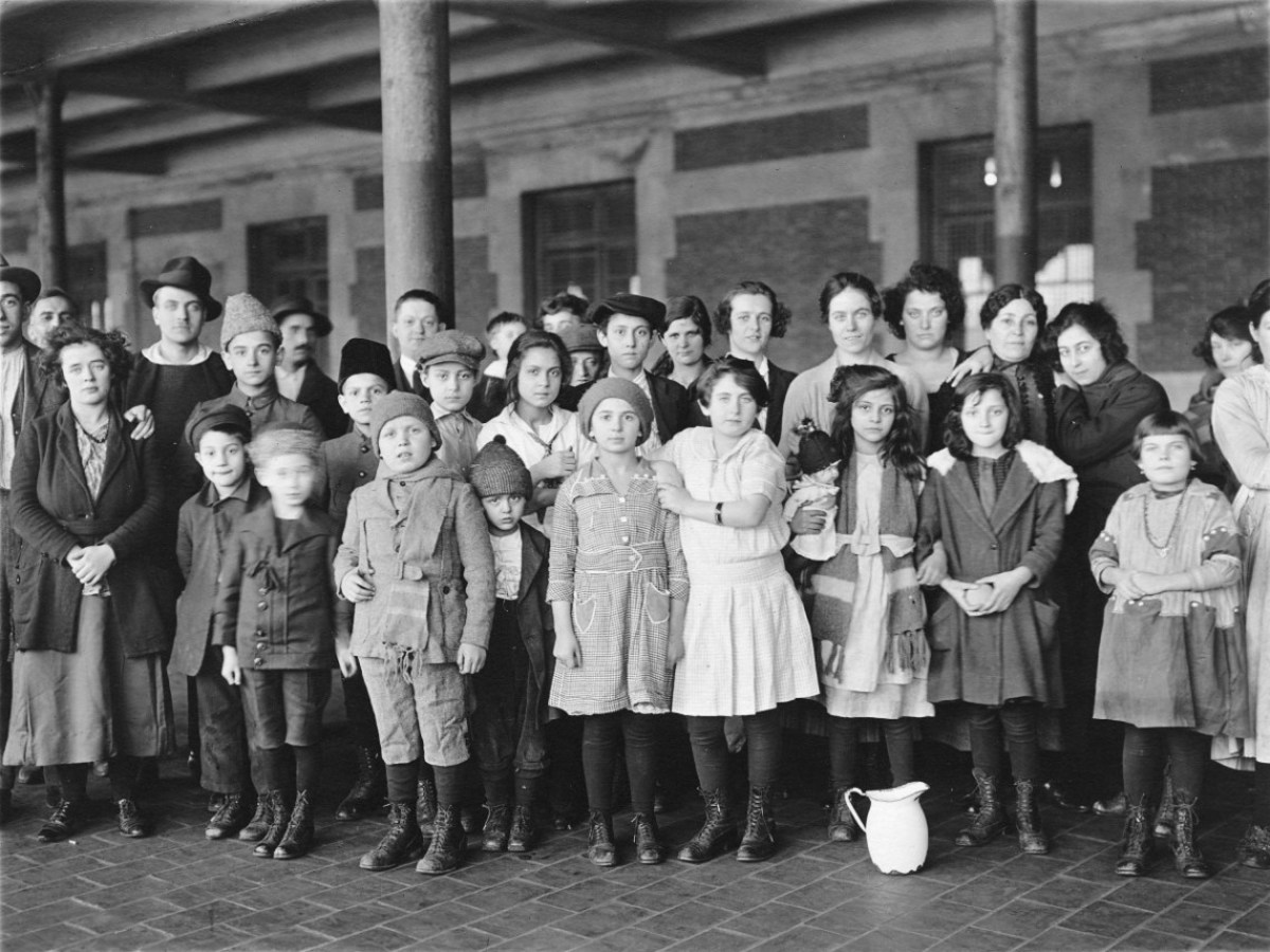 Immigrant children on Ellis Island.  On the American east coast there were two immigration waves: from 1820-1870 and 1870-1920.  All lived in horrid conditions in American cities, which also prompted their move westward.