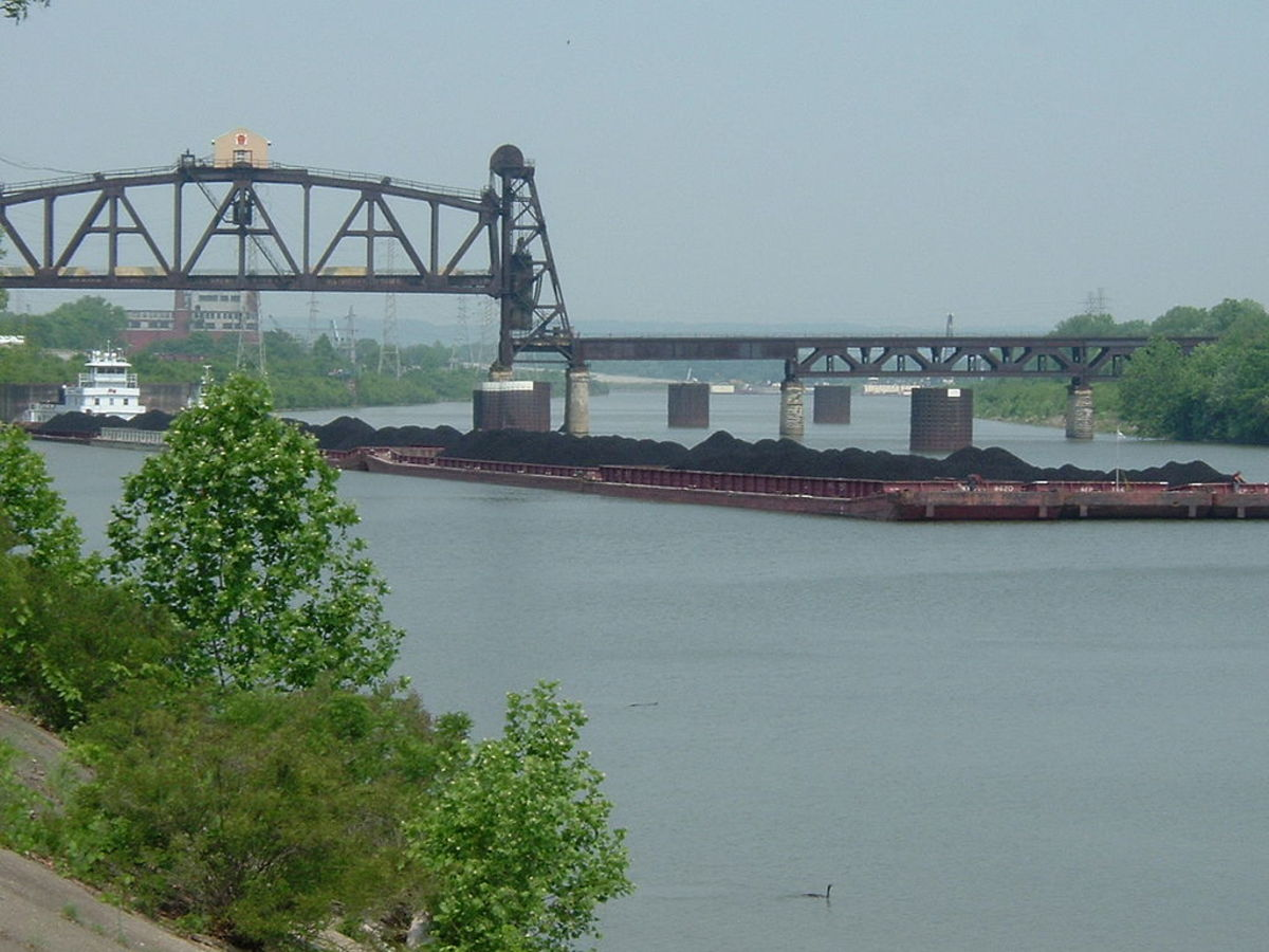 A barge hauling coal on the Louisville and Portland Canal
