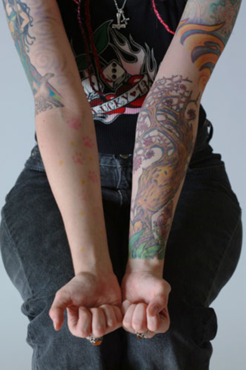 Nice collection of tattoo forming a female full sleeve
