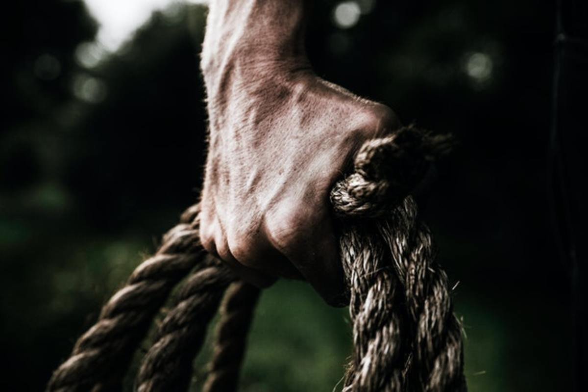 pexels-evelyn-chong-man-holding-brown-rope