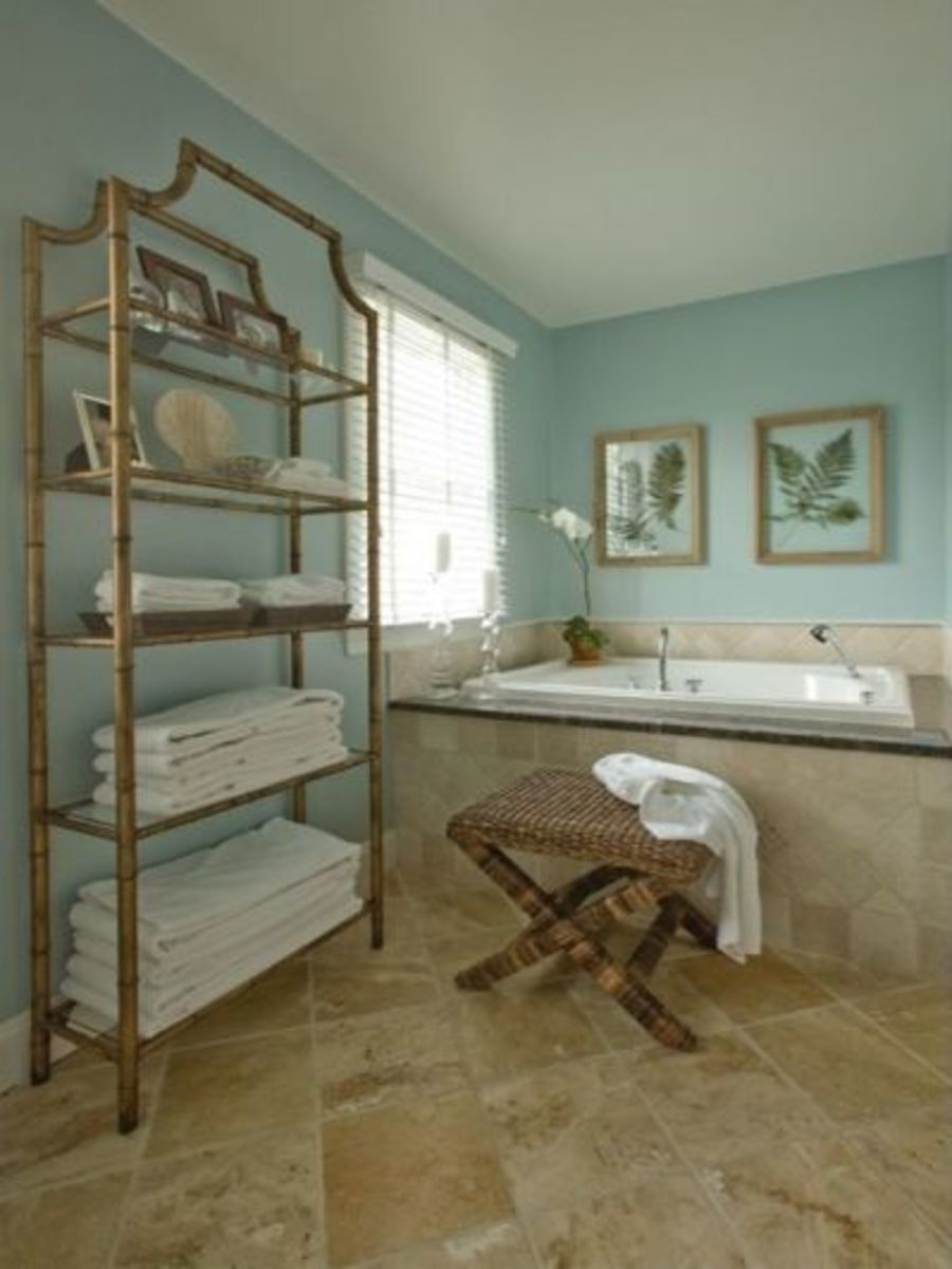 The Tiger bathroom should incorporate bamboo or other wood products. Play with colors like blue, green, and white. There should be enough room to sprawl. Opt for big white towels.
