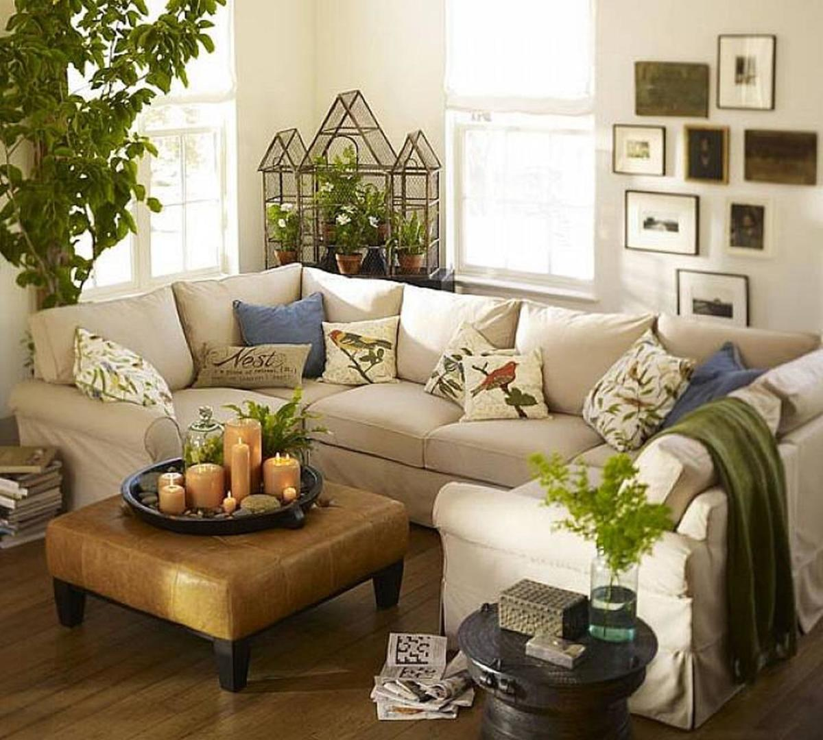 The Tiger living room should feel busy. There should be lots of patterns. A mix of white and green. Wooden furniture. And a sprawling sofa.