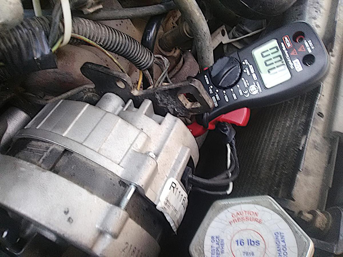 Check alternator's alternating current (AC) output.