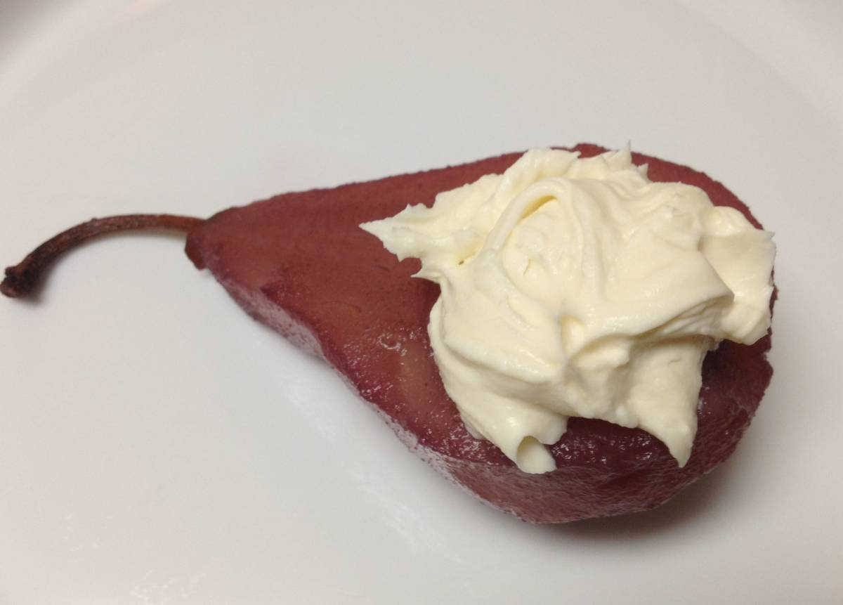 A pear half poached in red wine and filled with a vanilla mascarpone. Yum!