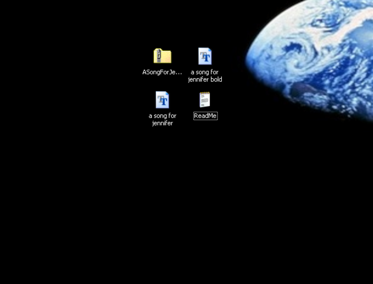 The extracted files on my desktop: two .ttf files and a ReadMe.