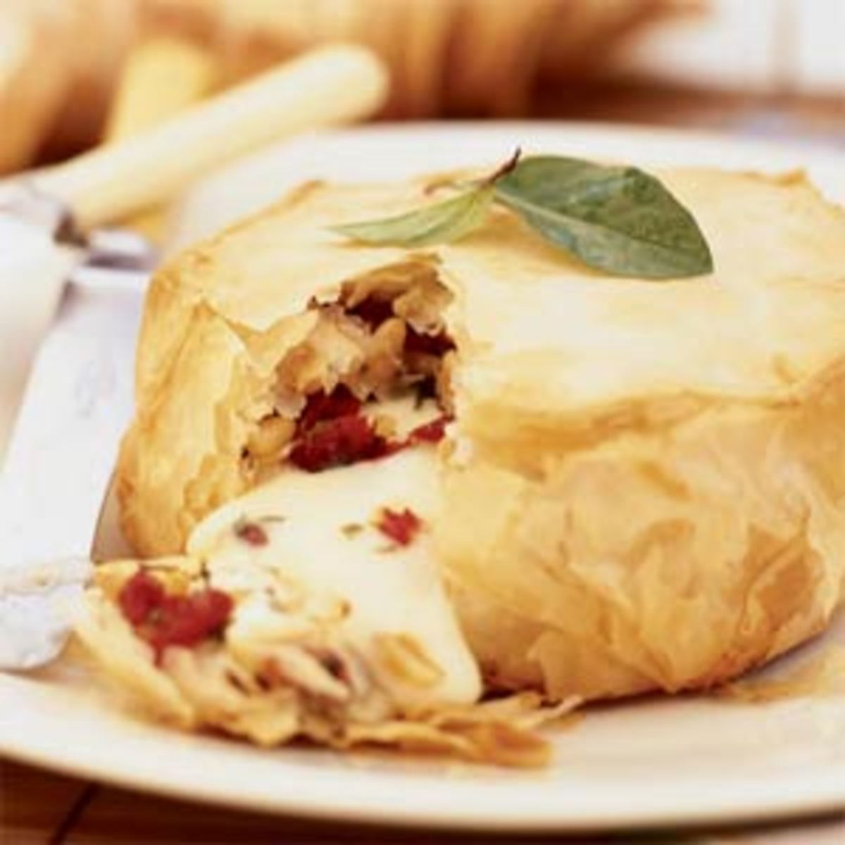"""Brie is an extremely popular French cheese that is often used as a """"stuffing"""" for savory pastries."""