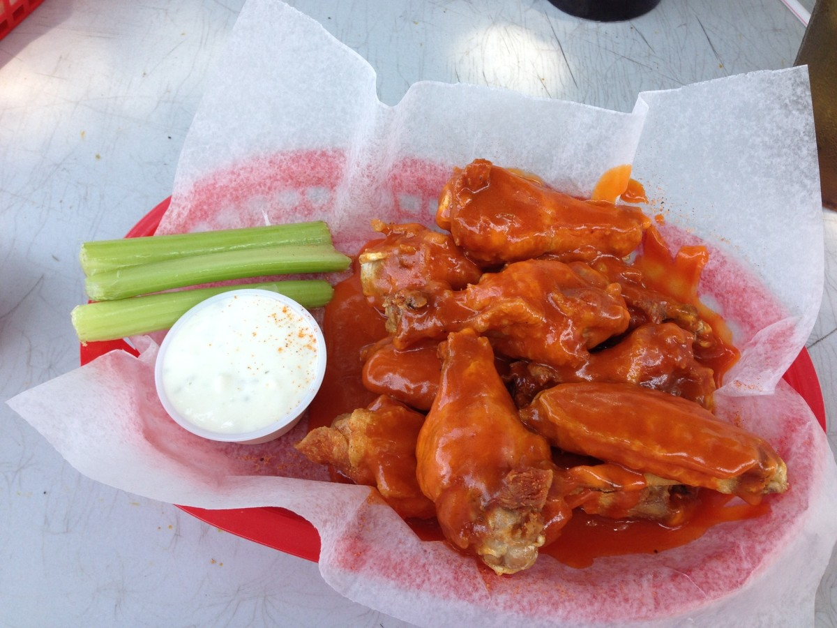 Buffalo chicken wings with celery and blue cheese dip