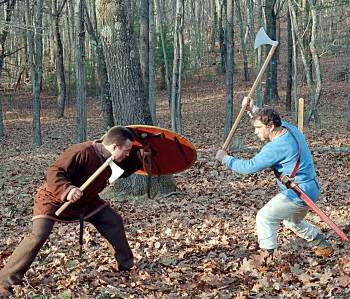 Axe combat. One man is armed with a Danish long-handled axe - these weapons could not be used easily in the shieldwall, and a man armed thus would need a comrade with shield and spear to watch his back