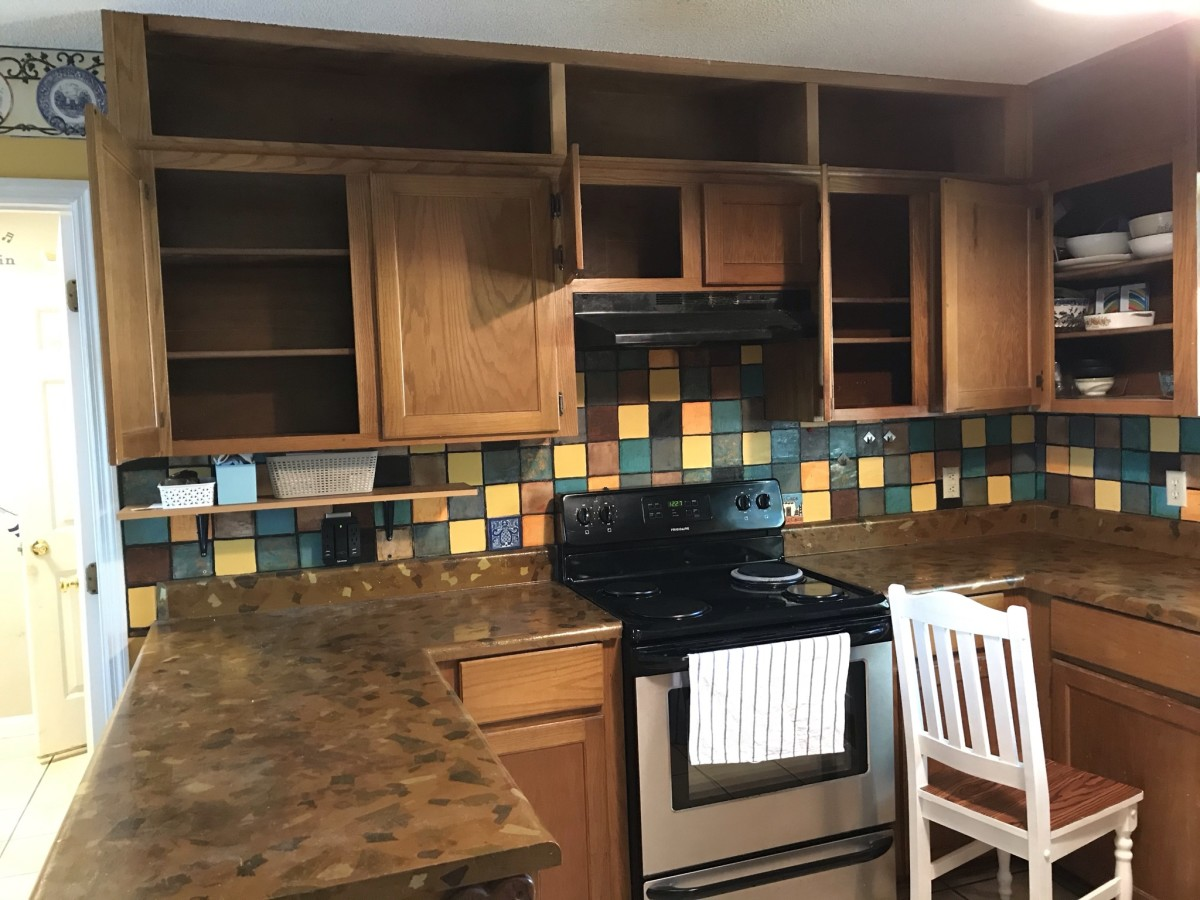 Note the solid color faux tiles.  I emptied the cabinets, so I could also update the cabinet finish.