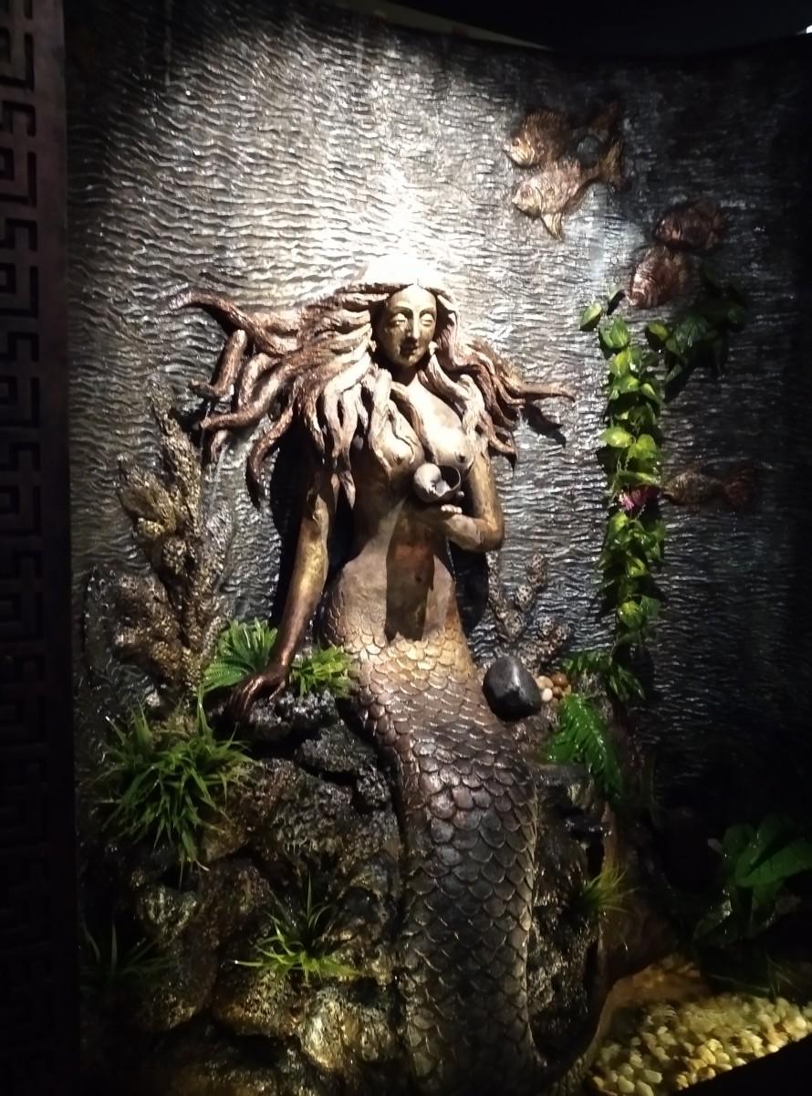 Sculpture of 'Matsyakanyaka' inside Aquarium