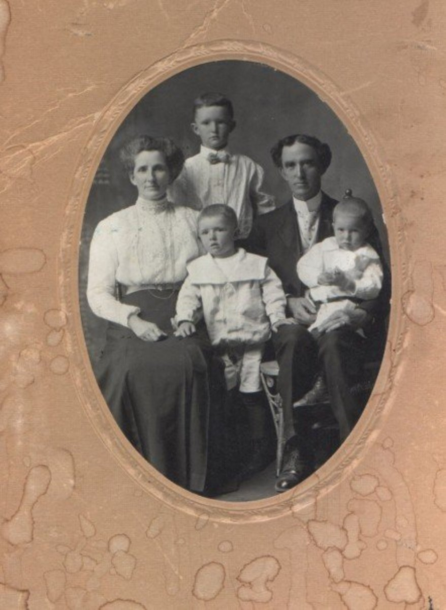 My Great-Grandparents John James Sanders and Catherine Merrick Sanders with my Grandfather William Bertram Sanders, the tall lad between his parents. c. 1908