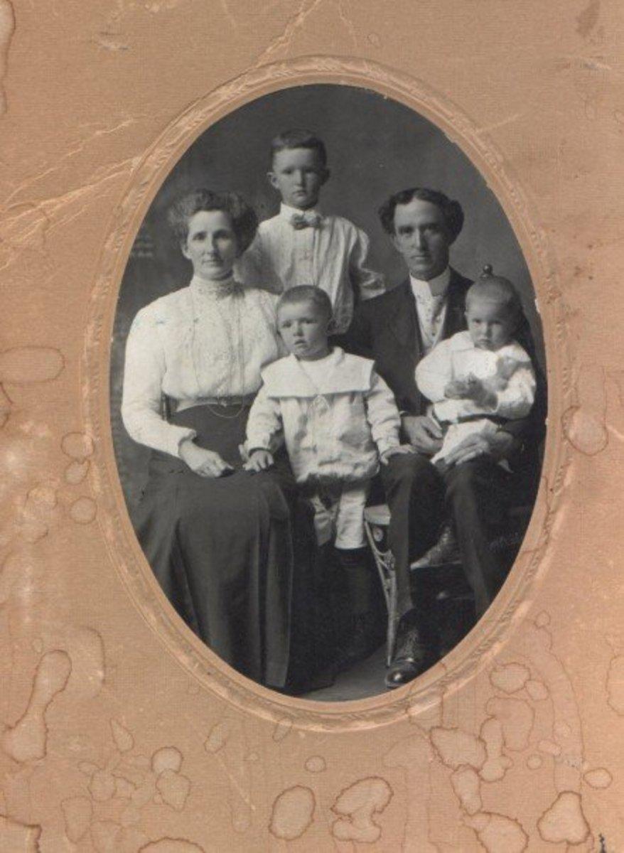 My Great-Grandparents John James Sanders and Catherine Merrick Sanders with my Grandfather William Bertram Sanders, the tall lad between his parents. c. 1908