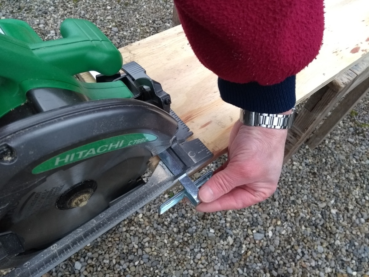 Adjusting the fence on my circular saw.