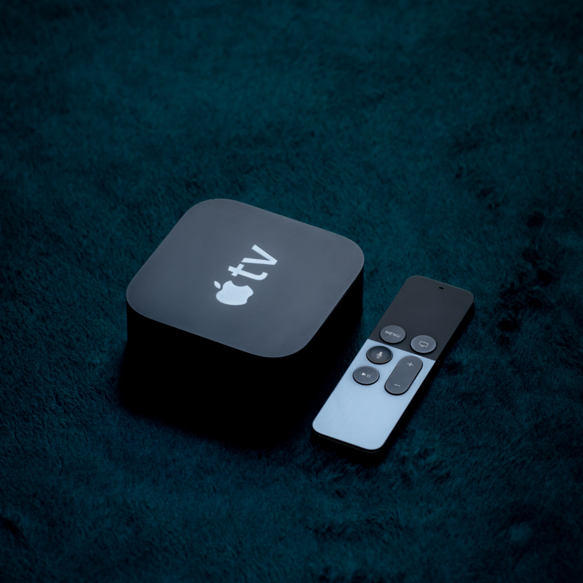 Apple TV box with remote.