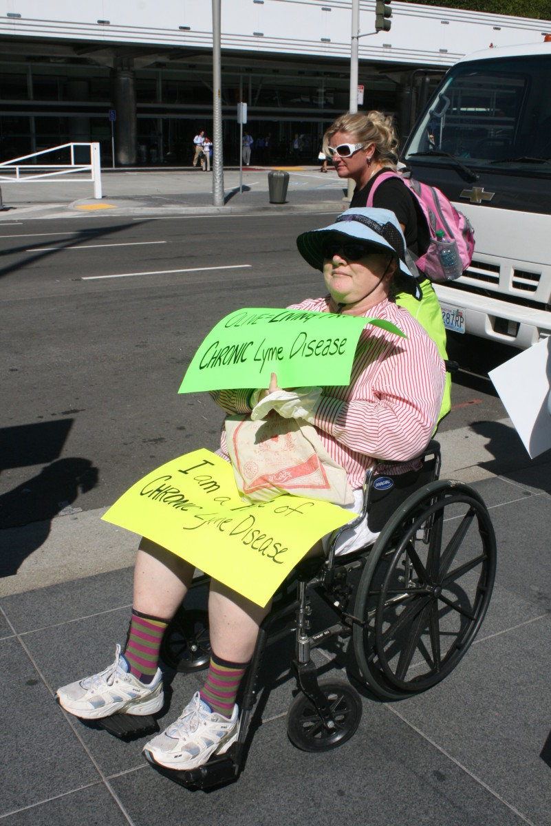 Wheelchair bound Lyme patient rallies outside of Infectious Disease conference asking for revised treatment guidelines.  San Francisco, 2013.