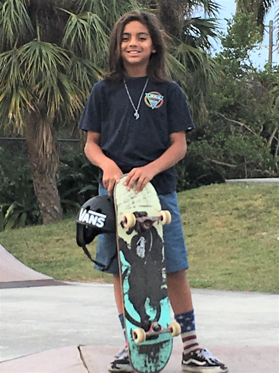 Kai with one of his favorite skateboards, a defining part of every rider.