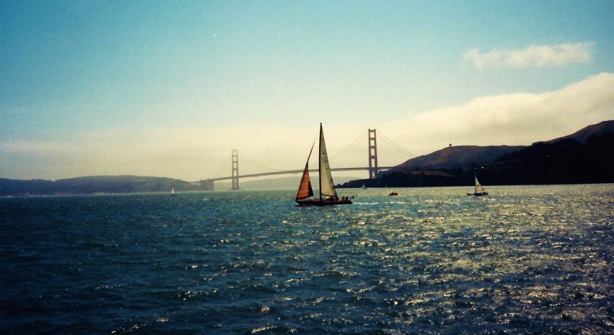 Sailboat with Golden Gate Bridge in background.
