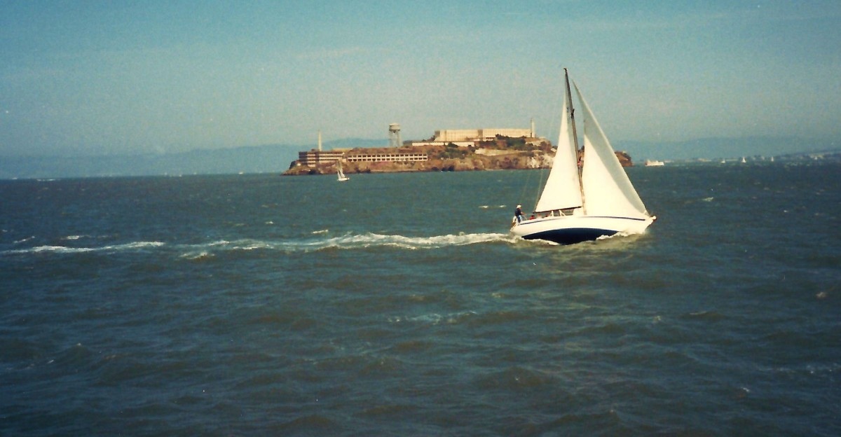Sailboats with Alcatraz in the distance.