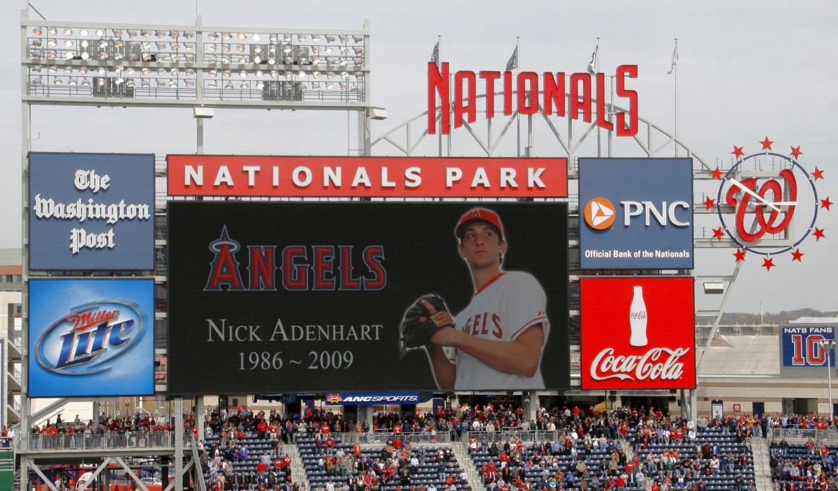 The Washington Nationals display a tribute to late Angels pitcher Nick Adenhart after he died suddenly in a vehicle accident at age 22 at the start of the 2009 season.