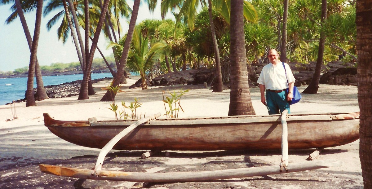 Old Hawaiian canoe & my hubby at Place of Refuge on Big Island of Hawaii
