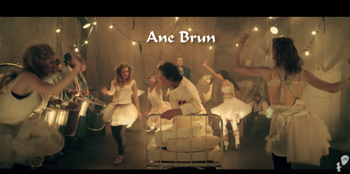 """The """"Do You Remember"""" music video has everything. Ane Brun singing, dancers in whimsical clothes, people banging drums, and a very confused man in a bed."""