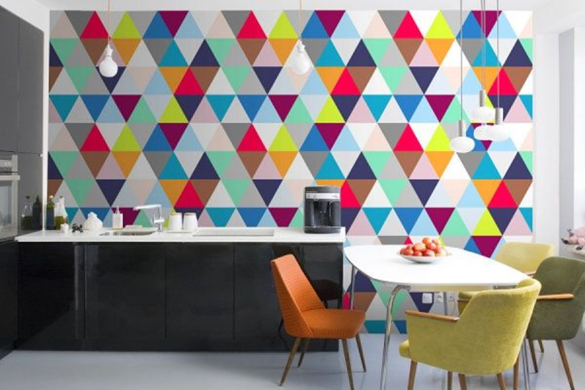 Check out all those triangles. The Snake Zodiac should have stripes in the living room, and triangles in the kitchen. Complement those triangles with the colors black, orange, yellow, red, and green.