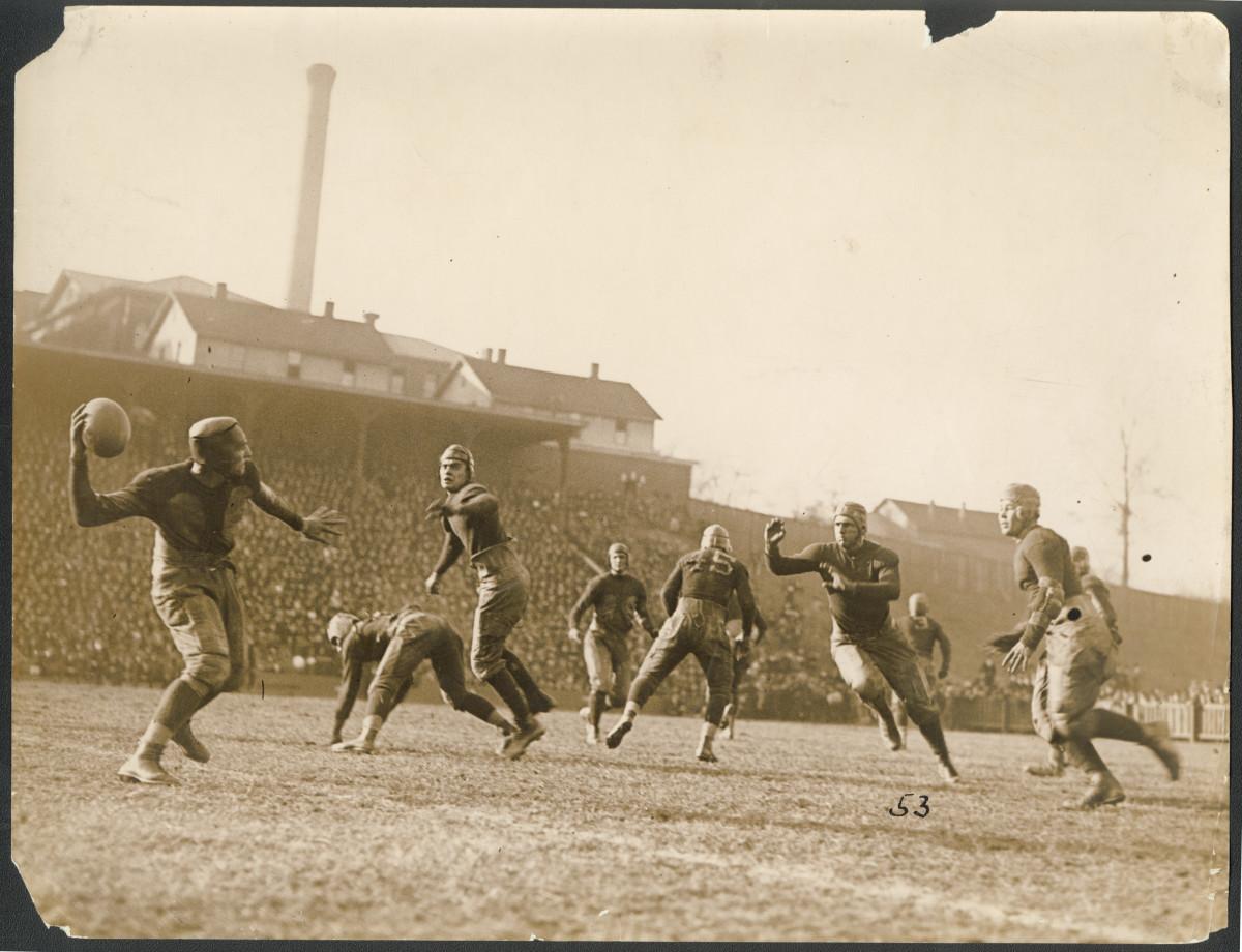 Forward pass in a football game.  Georgia Tech Auburn football game Thanksgiving 1921