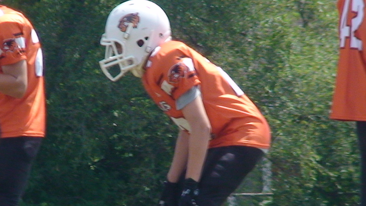 My youngest son as running back for his rep team waiting for the ball.