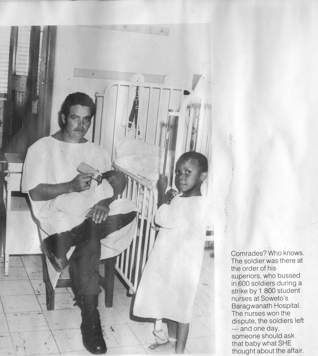 SADF Soldier taking care of African Children