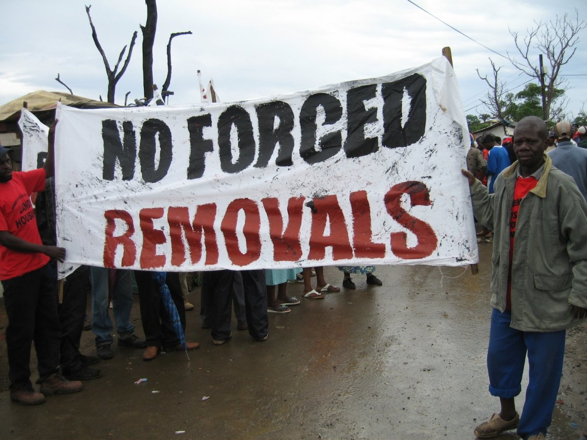 Poster held by protesters against forced removals from their slums