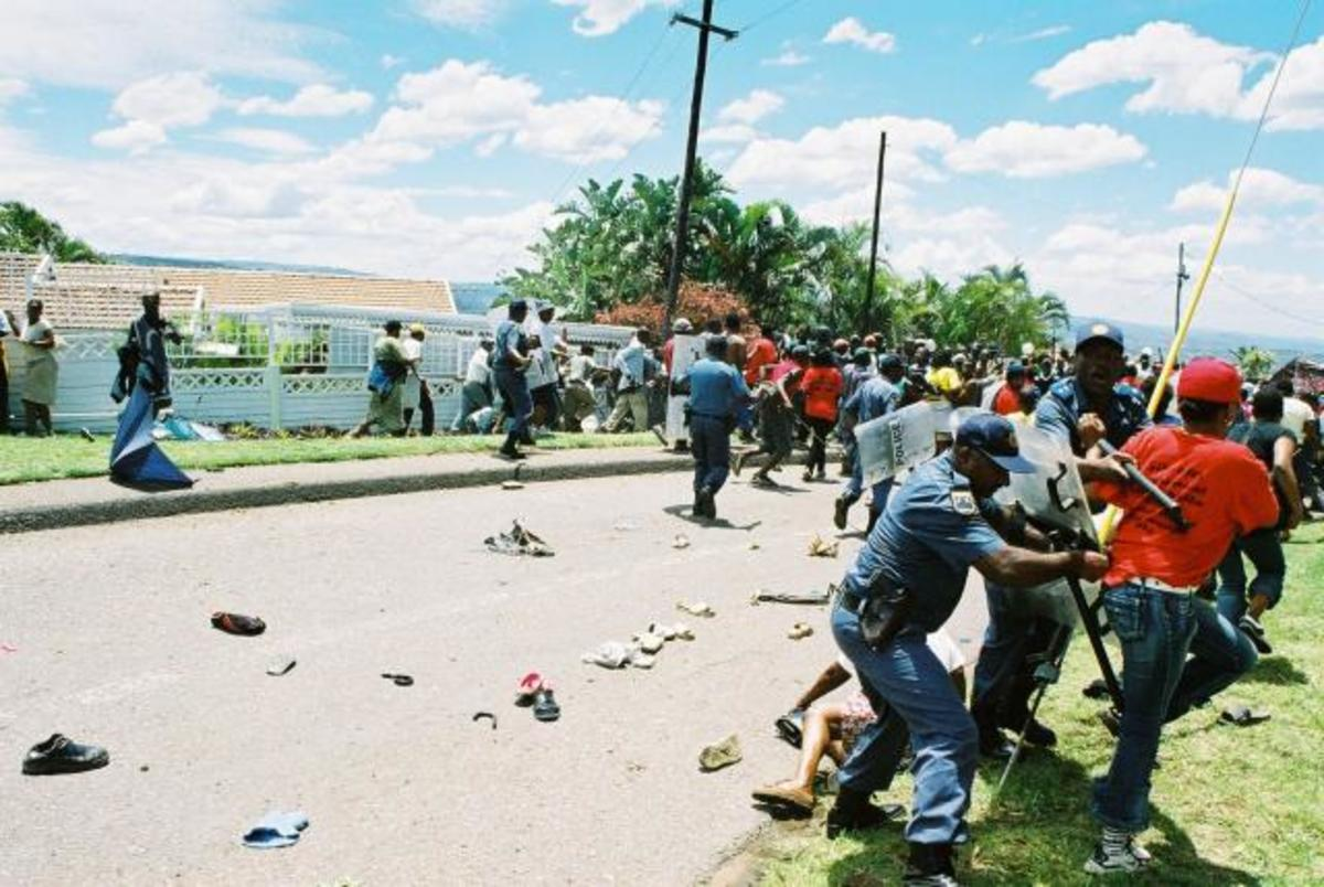 Grave concerns about the Etention without Trial of the Kennedy thrirteen who were arrested in the aftermath of the attact of the Abahlali baseMjondolo, as seen on the photograph in the Kennedy Road Settlement who are demanding equality for all people