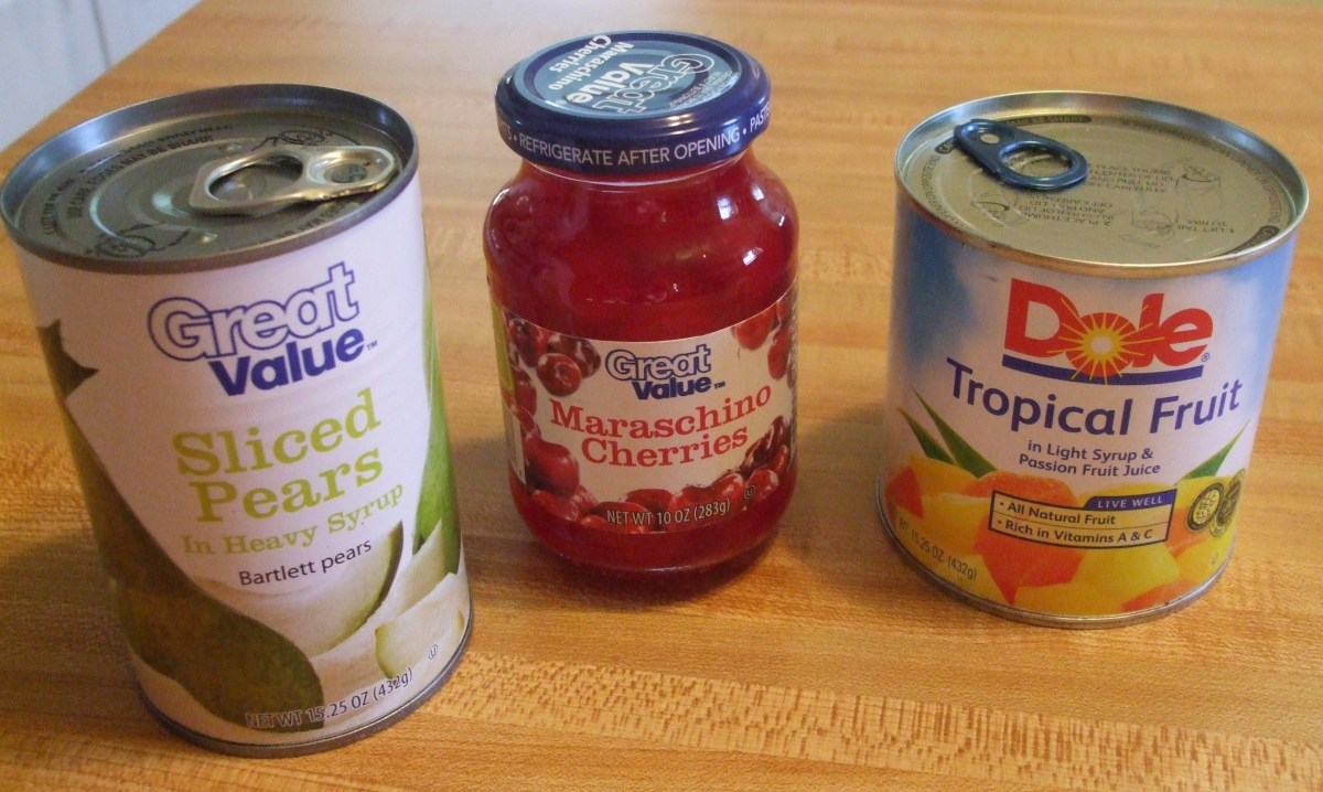Three cans or jars from the grocery store.