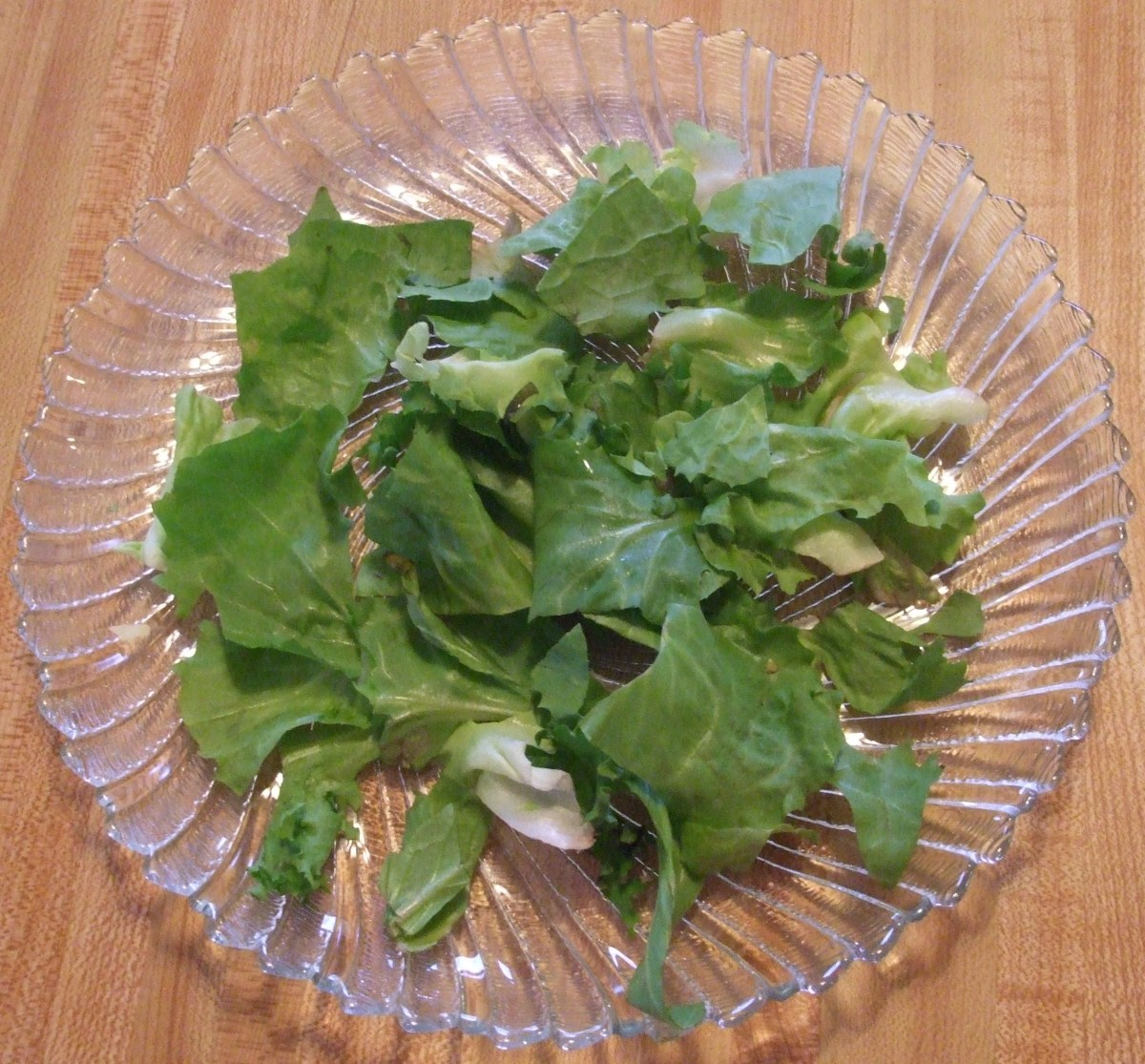 Greens spread on a salad plate.