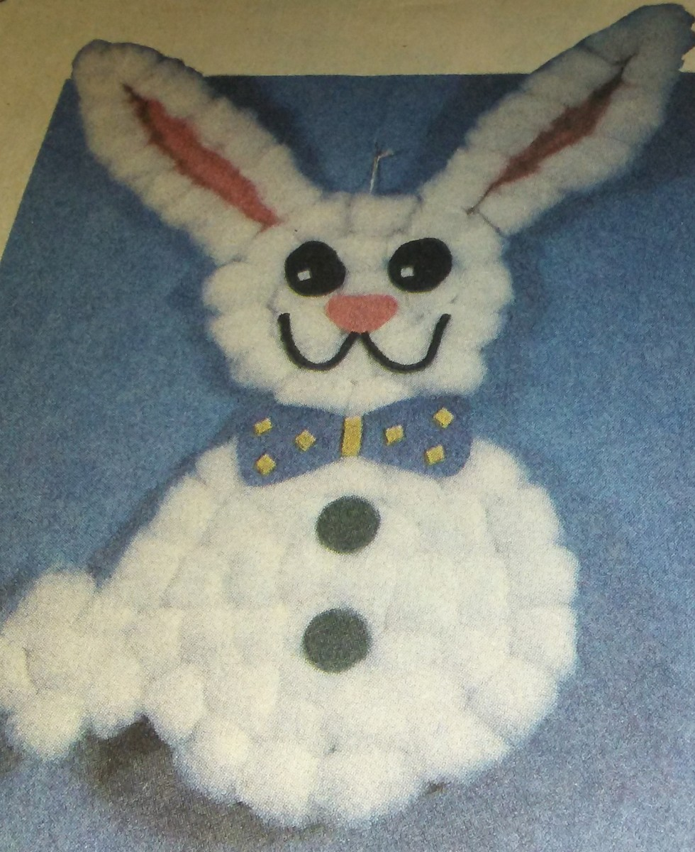 Your child will improve her pincer grasp by making this charming cotton-ball rabbit.