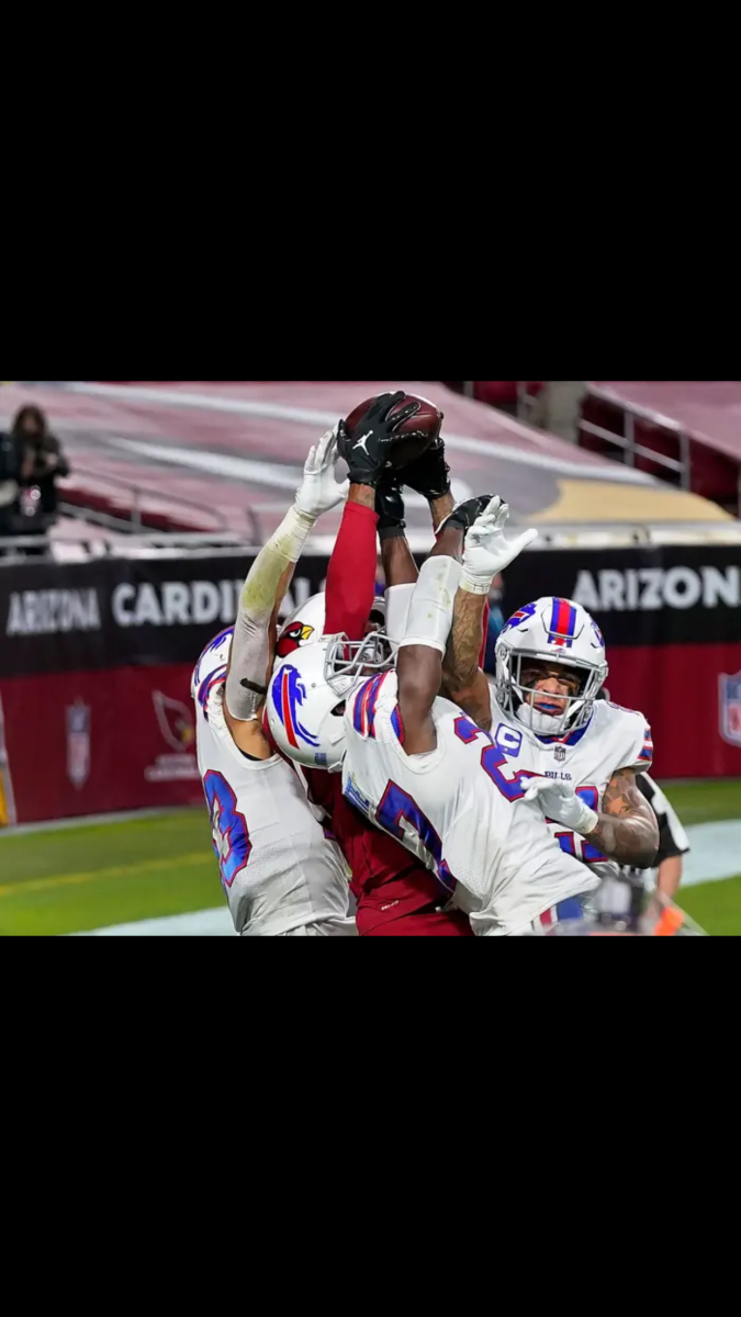 DeAndre Hopkins proves his elite status as he catches a game winning Hail Mary over three Buffalo defenders.