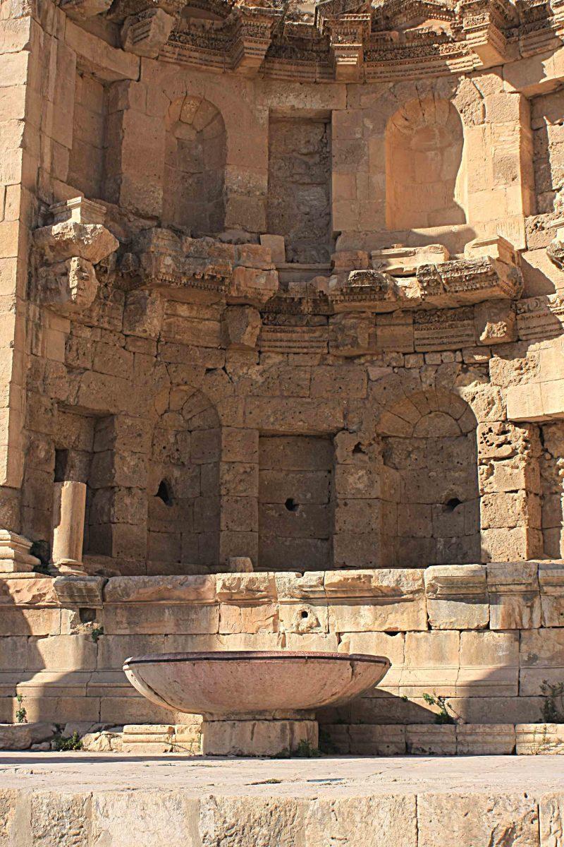 The late 2nd century Nymphaeum, or public fountain near the Temple of Dionysus. The large bowl collected the waters of the fountain