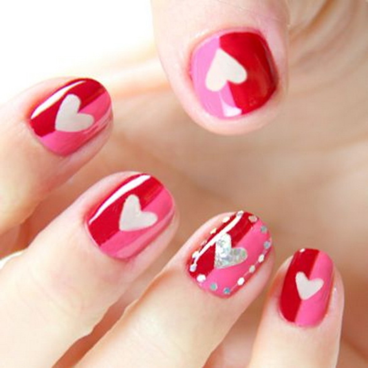 Red and pink heart nails