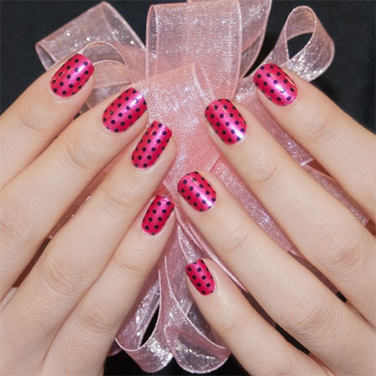 Pink polka-dotted nails