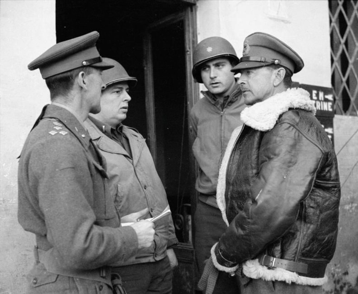 General Alexander (right) meets with his staff in Italy.
